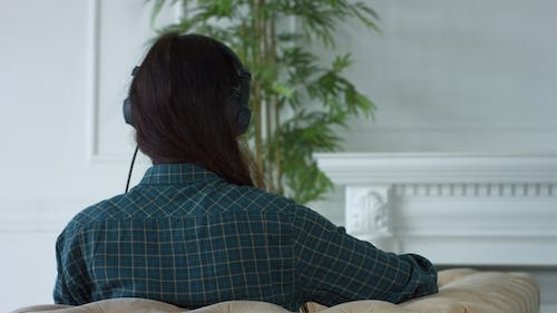 Happy Woman in Headphones Listening To MP3 Player