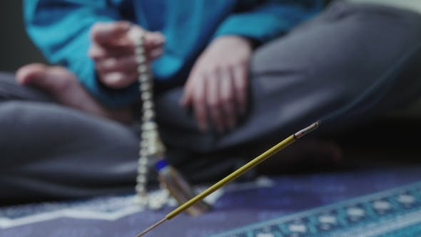 Thumbnail for Woman, Lit Hand, Counts Malas, Strands of Beads Used for Keeping Count During Mantra Meditations