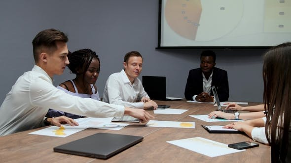 Cover Image for A Group of Creative Multi-ethnic Managers Disassemble at the Meeting of the Board of Directors in