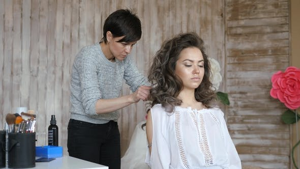 Thumbnail for Makeup Artist Stylist Works with Model. Hairdresser Does the Hair Styling of the Model. Hairdresser