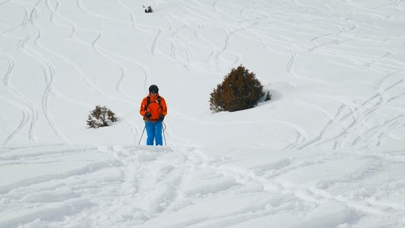 Thumbnail for Amazing View of a Snow Capped Hill with Skier Riding Downhill