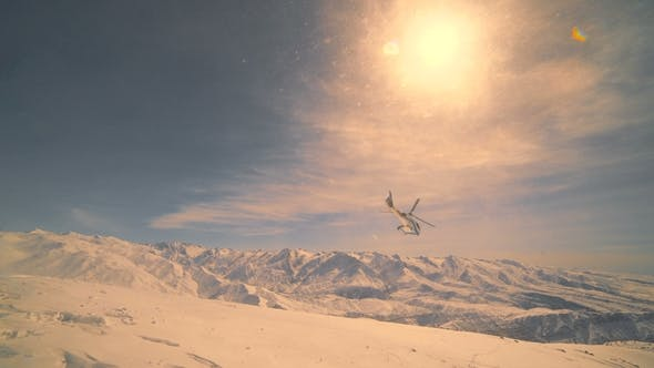 Thumbnail for Helicopter Flies Against the Background of Snow Mountains and Sunset