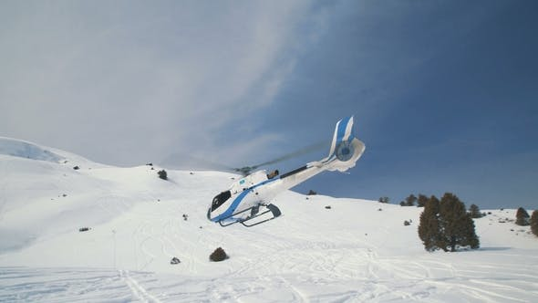 Thumbnail for The Helicopter Takes Off and Flies Away Against the Background of the Snow Mountains
