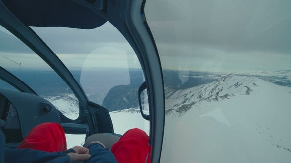 Cover Image for Helicopter Cockpit Flies in Winter Mountains