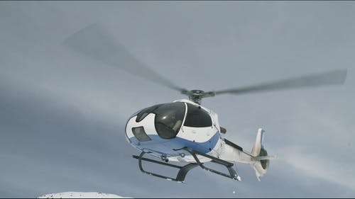 Helicopter Takes Off and Flies Low Over the Ground