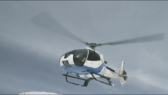 Thumbnail for Helicopter Takes Off and Flies Low Over the Ground