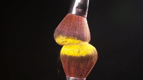 Cosmetic Brush with Golden Cosmetic Powder