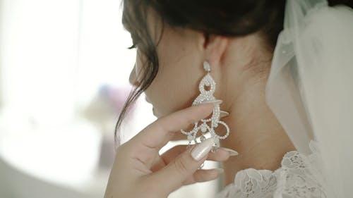 Long Earring Hanging from Girl's Ear