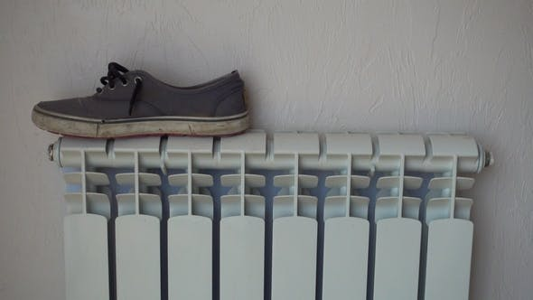 Thumbnail for Heating Radiator. Shoes, Keds, Drying After Rain