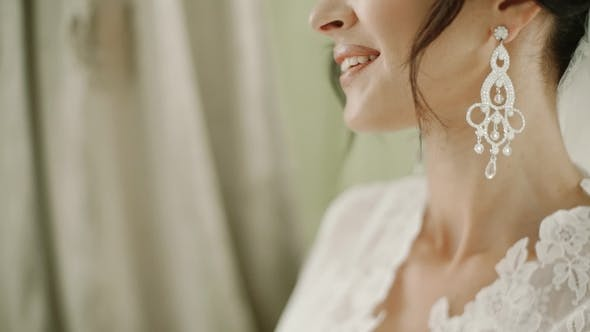 Smile Bride Bottom of the Girl's Face Ear of Which Hangs a Long Earring