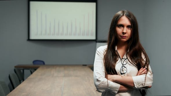 Thumbnail for Beautiful Girl in Office Clothes Standing in Conference Room with Glasses