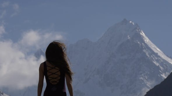 Thumbnail for Young Fragile Woman in the Face of a Big Snow Mountain