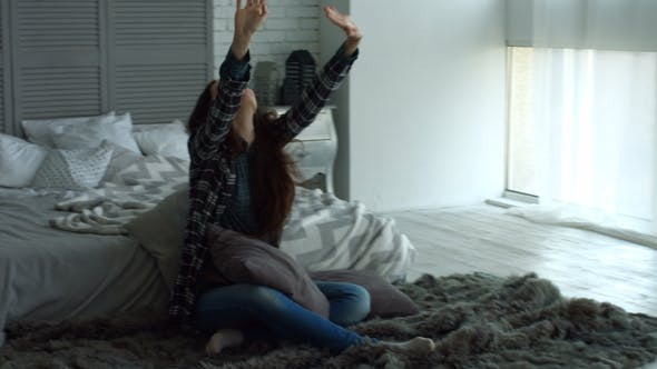 Thumbnail for Positive Woman Stretching Her Arms in Bedroom