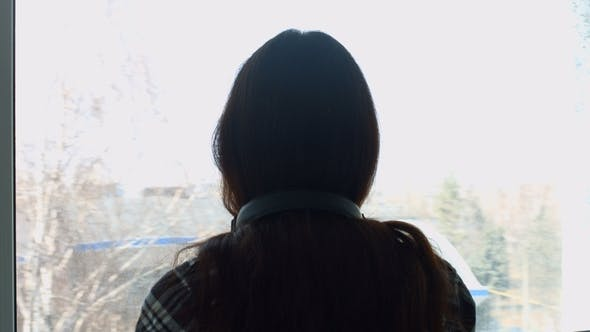 Thumbnail for Melancholic Young Woman Leaning on Window