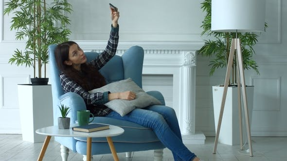 Thumbnail for Smiling Woman Taking Selfie on Smart Phone at Home