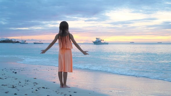 Thumbnail for Adorable Happy Little Girl on White Beach at Sunset.