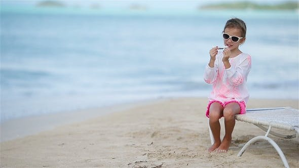 Thumbnail for Happy Little Girl with Toy Airplane in Hands on White Sandy Beach