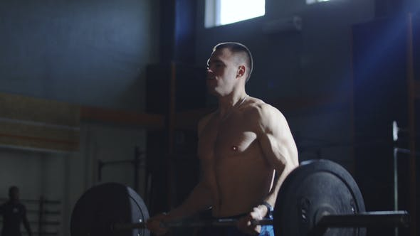 Thumbnail for Strong Shirtless Athlete Lifting Barbell in Sunny Gym