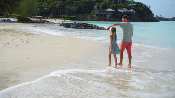 Thumbnail for Family Walking on the Beach. Dad and Kid Together on the Seashore