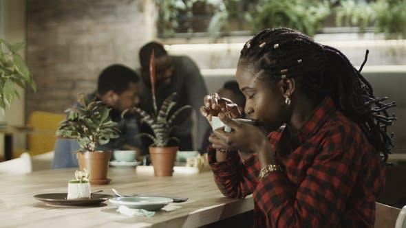 Young Black Girl Drink Cofee