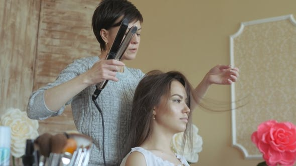 Thumbnail for Makeup Artist Stylist Works with Model. Hairdresser Does the Hair Styling of the Model
