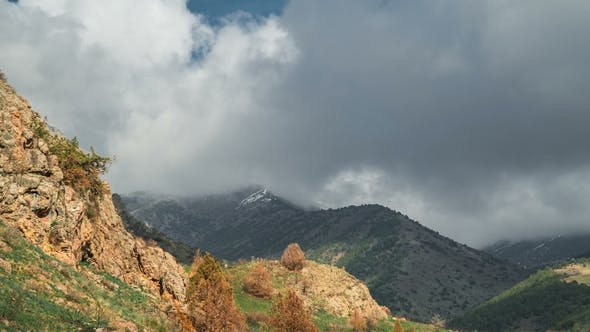 Cover Image for Spring Time in the High Mountains on the Background Cloudy Sky in