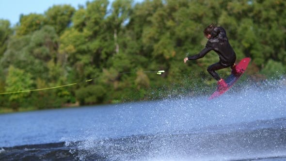 Thumbnail for Man Wakeboarder Making Tricks on Water. Man Falling Down in Water