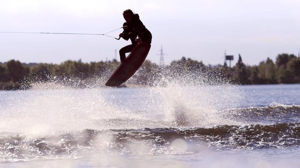 Man Making Extreme Jump on Wakeboarding Extreme Water Sports