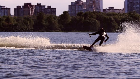 Thumbnail for Guy Rushing Along Lake on Water Board Extreme Sport Wakeboarding