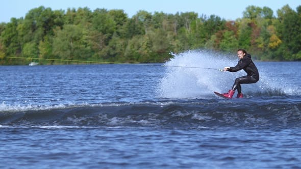 Thumbnail for Wakeboarder Jumping High Above Water. Rider Wakeboarding