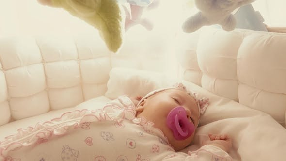 Thumbnail for Cute Baby Girl Sleeping in Her Cot