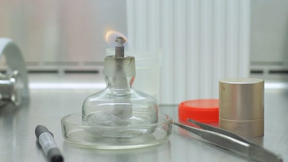 Thumbnail for Candle Stick with Fire on Laboratory Table