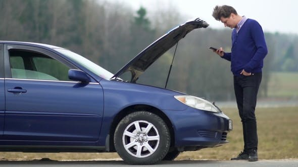 The Man Broke the Car. Uses a Mobile Phone