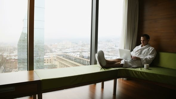 Businessperson Working at Home or in Trip