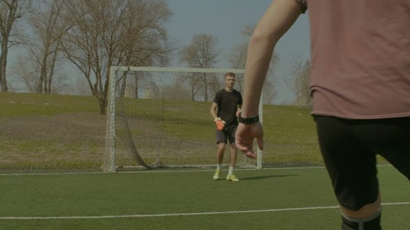 Thumbnail for Teenager Goalkeeper Giving a Pass To Teammate