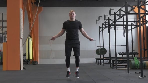 Thumbnail for Fitness Man Doing Double Jumps Rope in the Gym
