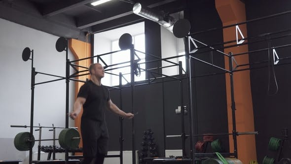 Thumbnail for Fitness Man Doing Double Jumps Rope Exercise in Gym