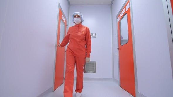 Cover Image for Female Scientist Going Out of Laboratory Room