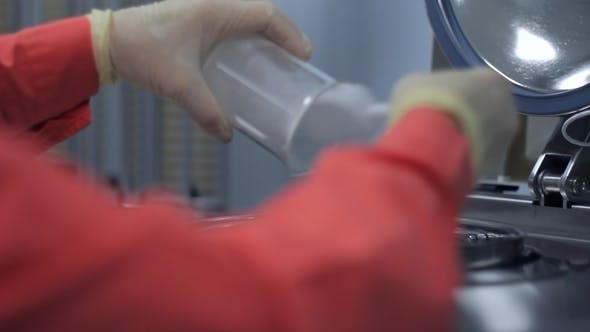 Thumbnail for Factory Worker Loading Chemical Powder Into Medicine Production Machine