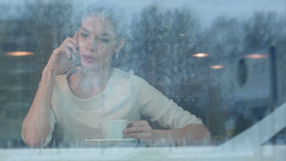Thumbnail for Upset Female Having Angry Phone Conversation While Sitting in a Cafe