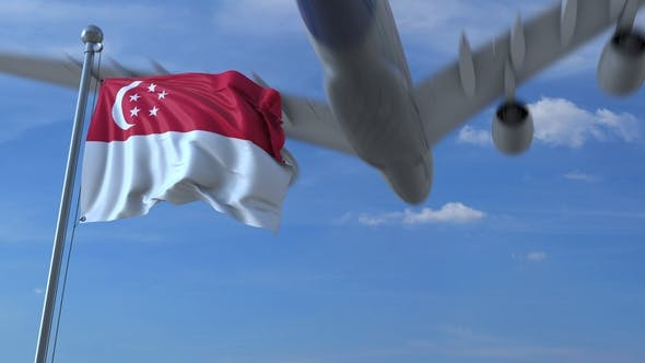 Thumbnail for Commercial Airplane Flying Above Waving Flag of Singapore