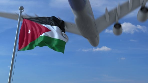 Thumbnail for Commercial Airplane Flying Above Waving Flag of Jordan
