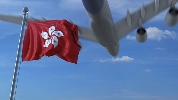 Thumbnail for Commercial Airplane Flying Above Waving Flag of Hong Kong