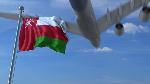 Thumbnail for Commercial Airplane Flying Above Waving Flag of Oman