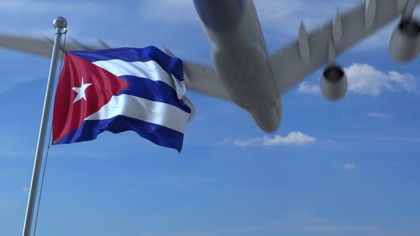 Thumbnail for Commercial Airplane Flying Above Waving Flag of Cuba