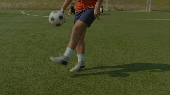 Thumbnail for Football Player Juggling Soccer Ball on the Pitch