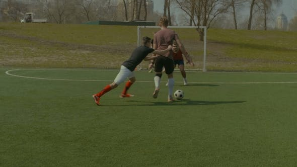 Thumbnail for Defender Committing a Foul During Football Match