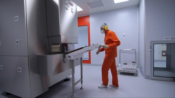 Thumbnail for Factory Worker Starting Work with Pharmaceutical Packaging Machine at Factory