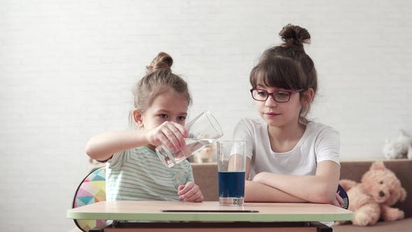 Children's Science. Children Mix Chemical Reagents and Observe the Reaction.