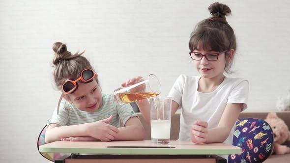 Thumbnail for Funny Children Conduct a Chemical Experiment and Mix Reagents. Kids Are Surprised and Happy Watching